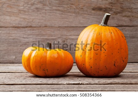 Autumn pumpkins on wooden board table. View with copy space