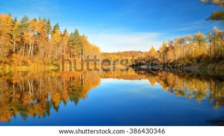 Autumn river Gauja in Sigulda, Latvia. Landscape with reflection - stock photo