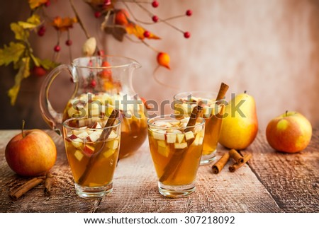Autumn  sangria with apples,pears and cinnamon - stock photo