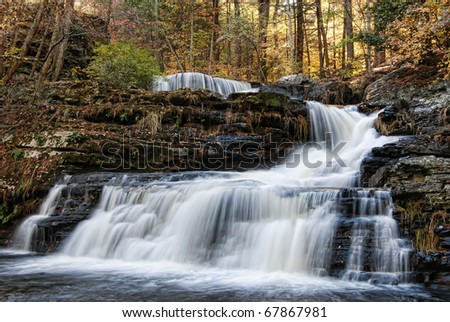 Autumn scene of Factory Falls, located in George W Childs State Park, Dingmans Ferry, Pennsylvania - stock photo