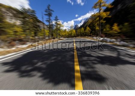 Autumn scene with road  - stock photo