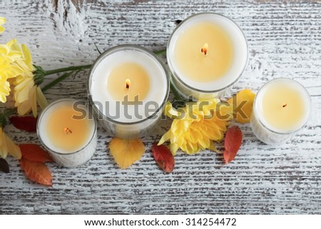 Autumn setting with candles - stock photo