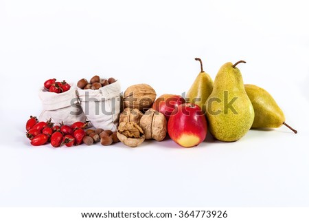 Autumn still life of fruit apples pears nuts rosehips isolated on white background - stock photo