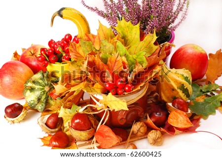 autumn still life with a bunch of colorful leaves and harvest - stock photo