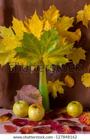 Autumn Still Life with apples and maple leaves