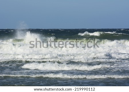 Autumn storm making big waves on the baltic sea - stock photo