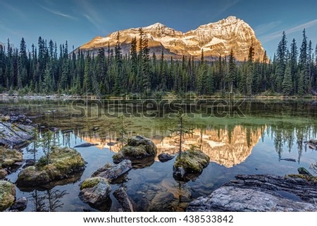 Autumn sunrise in the rocky mountains of British Columbia. from the shore of Lake O'Hara in the wilderness of Yoho National Park - stock photo