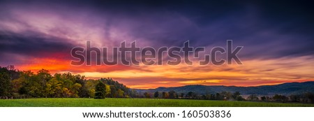 Autumn sunset panorama of Cade's Cove in Great Smoky Mountains National Park - stock photo