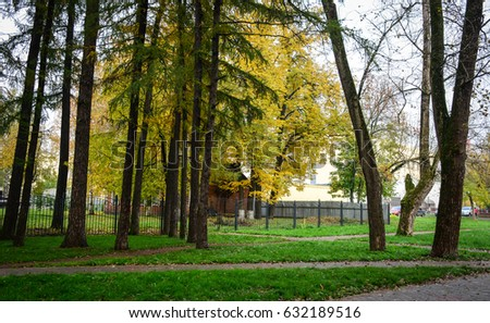 Autumn trees at the central park in Sergiev Posad, Russia. Sergiev Posad is famous for its monastery, the spiritual home of the Orthodox Church.