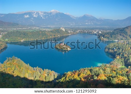 Autumn view of Bled with the island and the castle from Mt. Osojnica, and Mt. Stol in the backrgound