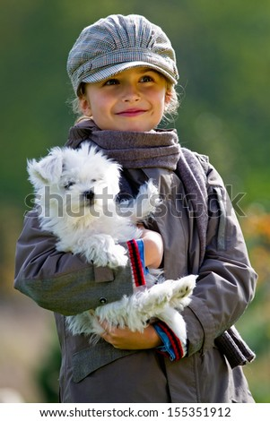 Autumn walk with puppy - fashion girl with maltese puppy in autumn park - stock photo
