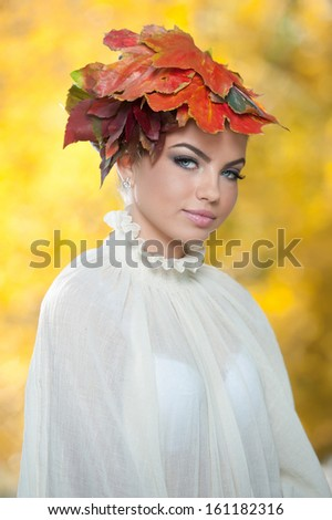 Autumn Woman. Beautiful creative makeup and hair style in outdoor shoot .Beauty Fashion Model Girl with Autumnal Make up and Hair style. Fall. Creative Autumn Makeup. Beautiful fashionable girl