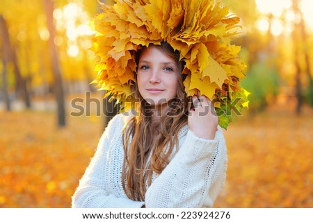 Autumn Woman. Blonde Girl and Yellow Leaves. Portrait. Fall.