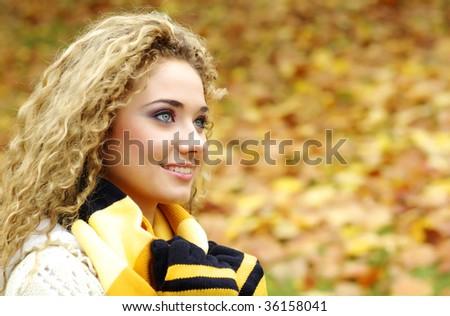 Autumn woman in park - stock photo