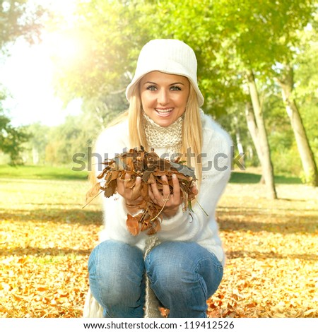 Autumn woman in the park. - stock photo