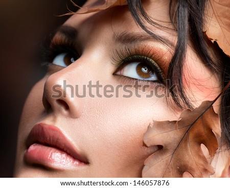 Autumn Woman Make up. Fall. Beautiful Stylish Girl With Professional Makeup  - stock photo