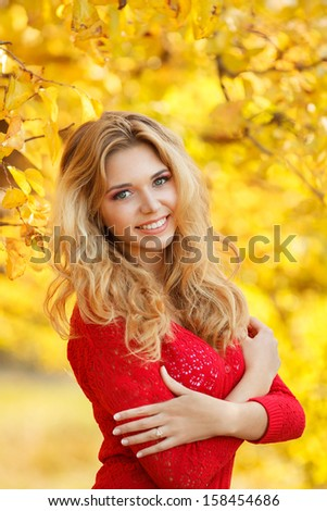 Autumn Woman Portrait. Beauty Fashion Model Girl with Autumnal Make up and Hair style. Fall. Creative Autumn Makeup. Beautiful Face. - stock photo
