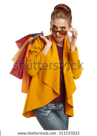 Autumn woman with shopping bags. Studio shoot - stock photo