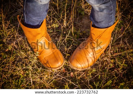 autumnal background with the jeans and cowboy boots - stock photo