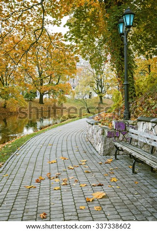 Autumnal park in the center of Riga. Riga is the capital and largest city of Latvia, a major commercial, cultural, historical and financial center of the Baltic region