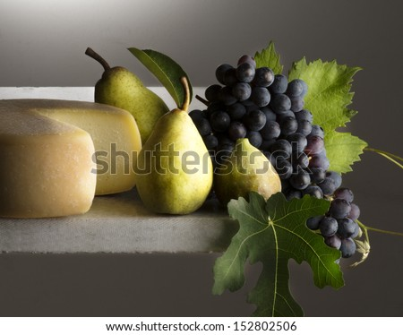 Autumnal still life with cheese - stock photo
