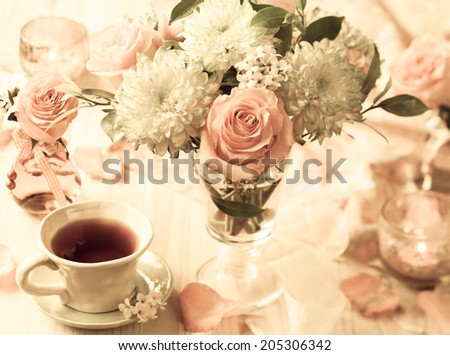 Autumnal table setting with  bunch of autumn flowers and cup of tea,vintage style - stock photo