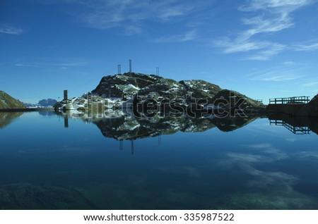 Autumnal view of Lake Nero and the hydroelectric dam, Valgoglio, Bergamo Alps, Italy - stock photo