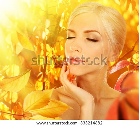 Autumnal woman fashion portrait with bright leaves - stock photo