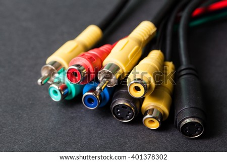 AV TV RCA composite audio video cables on black background - stock photo