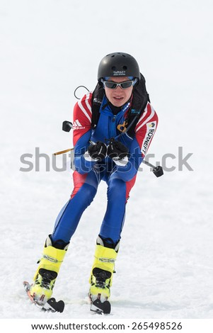 AVACHA, KORYAK VOLCANOES, KAMCHATKA, RUSSIA - APRIL 27, 2014: Ski mountaineer Alexey Filippov rides from mountain. Team Race ski mountaineering Asian, ISMF, Russian, Kamchatka Championship. - stock photo