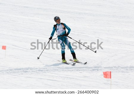 AVACHA, KORYAK VOLCANOES, KAMCHATKA, RUSSIA - APRIL 27, 2014: Ski mountaineer Konstantin Savchuk rides from Avacha Volcano. Team Race ski mountaineering Asian, ISMF, Russian, Kamchatka Championship. - stock photo