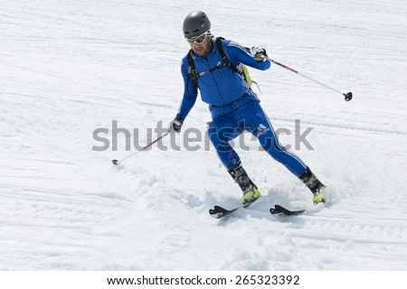 AVACHA, KORYAK VOLCANOES, KAMCHATKA, RUSSIA - APRIL 27, 2014: Ski mountaineer skiing the mountain. Team Race ski mountaineering Asian, ISMF, Russian, Kamchatka Championship. - stock photo