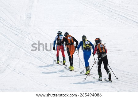 AVACHA, KORYAK VOLCANOES, KAMCHATKA, RUSSIA - APRIL 27, 2014: Two teams of ski mountaineers climb the mountain on skis. Team Race ski mountaineering Asian, ISMF, Russian, Kamchatka Championship. - stock photo