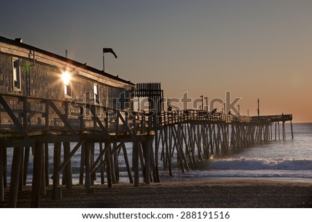 Avalon fishing Pier in Kitty Hawk on the Outer Banks is a popular destination. - stock photo