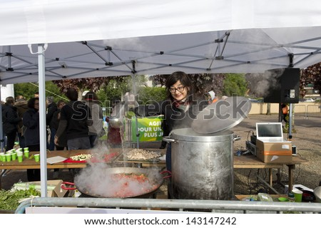 AVALON, FRANCE - May 25: Unidentified volunteer preparing soup for participants in the 2013 Trailwalker for Oxfam May 25, 2013 in Avalon France. Athletes completed 100 Km in under 30 hours. - stock photo