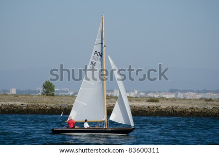 AVEIRO, PORTUGAL - AUGUST 27: Participant boat on the competition during the 49th Cruzeiro da Ria August 27, 2011 in Aveiro, Portugal.