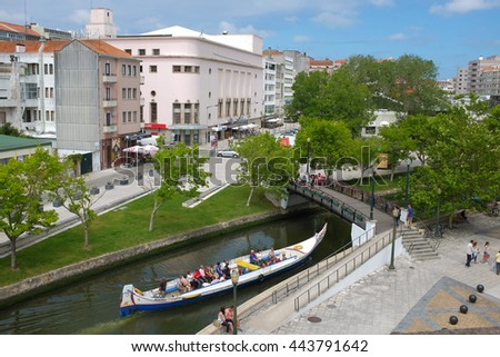 Aveiro, Portugal - 17 June 2016. Typical Moliceiro boat in the canals of the city of Aveiro in Portugal - stock photo