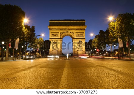 Avenue des Champs-Elysees in Paris leading up to the international landmark the Arc de Triomphe - stock photo