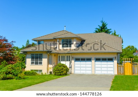 Average family house on a sunny day in Vancouver, Canada. - stock photo