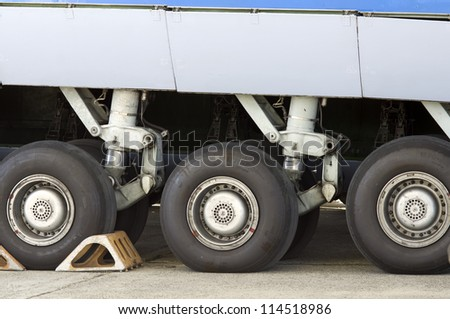 Aviation chassis of large transport aircraft, closeup - stock photo