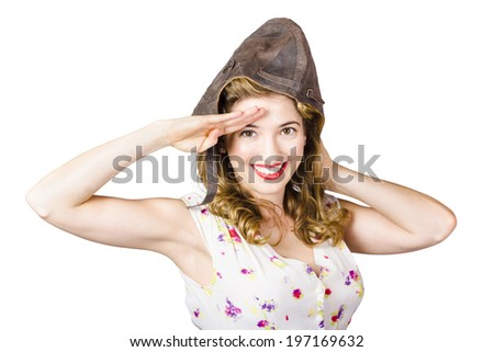Aviation pin up lady saluting with smile and perfect make up in fighter pilot cap on white background. Military pinups - stock photo