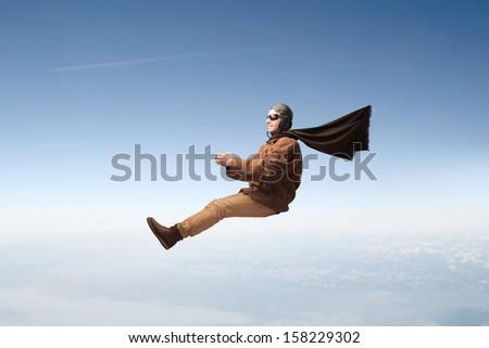 aviator flying in the sky - stock photo