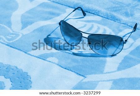 aviators on a towel - aqua tone - stock photo