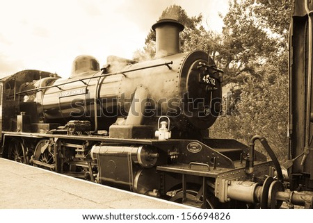 AVIEMORE, SCOTLAND - JULY 8: LMS Ivatt 46512 Class 2 2-6-0 locomotive, one of only seven remaining on July 8, 2013 in Aviemore, Scotland - stock photo