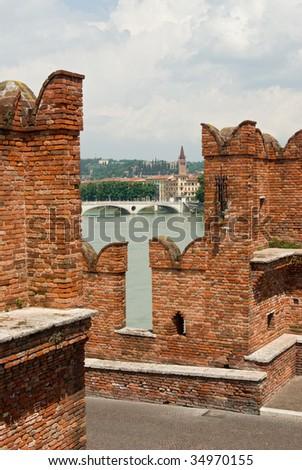 Aview of the city of Verona, Italy, from an ancient stone bridge - stock photo