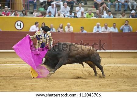 AVILA, SPAIN - JUNE 2: Francisco Rivera Ordoez fights in the welfare bullfight of Avila, a city near to Madrid in the middle of Spain in June 2, 2012. - stock photo