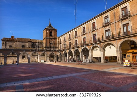 AVILA, SPAIN - MAY 10, 2014 Plaza Mayor Walls Arches Avila Castile Spain.  Described as the most 16th century town in Spain.  Walls created in 1088.  Inquisition site. - stock photo