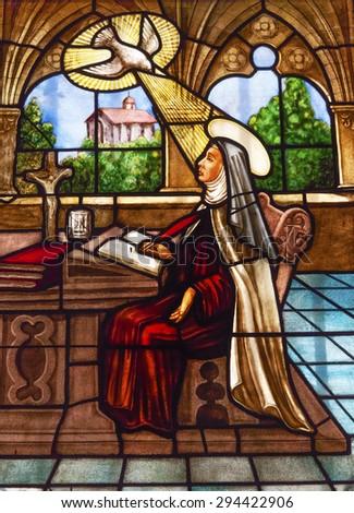 AVILA, SPAIN -  MAY 10, 2014 Saint Teresa Stained Glass Convento de Santa Teresa Basilica Avila Castile Spain.  Convent founded 1636 for St Teresa Catholic nun, Spanish mystic founded Carmelite order. - stock photo