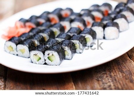 Avocado and other sushi sets - stock photo