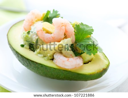 Avocado and Shrimps Salad. Appetizer - stock photo